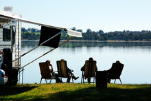 Caravaners Relax Beside Lake