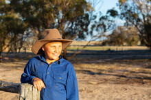 Farm Kid Wearing Work Shirt An...