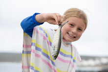 Little Girl On The Beach Holdi...