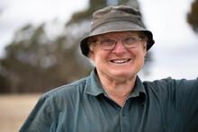 Smiling Old Man Wearing Glasse...