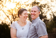 Joyful Middle Aged Couple Standing Together In Afternoon Light - Faithfulness