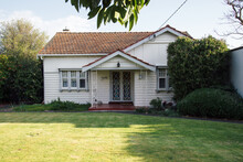 A Small, White, Old Weatherboard House
