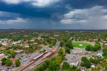 Aerial View Of A Thunderstorm Approaching A Regional Town With A Railway Line And Football Oval