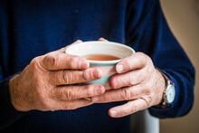 Elderly Hands Holding A Warm C...