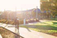 Sun Haze Over Cyclist Riding O...