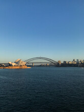 Sunrise View Across Harbour To Opera House And Harbour Bridge