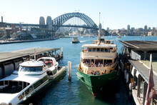 Manly Ferry At Circular Quay With Harbour Bridge In The Background