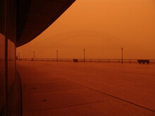 View Of Boardwalk And Sydney Harbor Bridge In Red Dust Storm