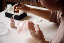 Positive Woman Creating Handma...