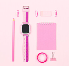 Flat Lay Sweet Girls School Stationery On Pink Background. Back To School Concept, Creative Layout. Top View, Overhead.