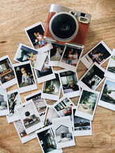 An Instant Camera And Film Lay...