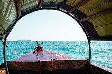 Front View Boat Floating On Ocean