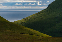 Green Slopes Of Mountains On Seacoast
