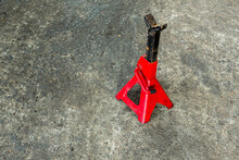Red Axle Stand On Floor. Red H...