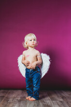 Toddler Boy In Jeans And Angel...