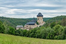 Beautiful View Of Gothic Castle Karlstejn. Medieval Castle Was Built In Gothic Style By King And Emperor Of Old Roman Rise, Charles IV. It Is Situated In Central Bohemia Near Prague - Czech Republic