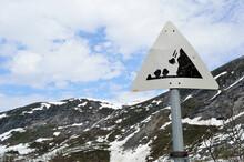 Danger Falling Rock Sign On Mountain