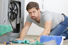 Man Cleaning Washing Machine L...