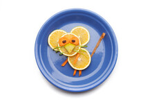 Food Art Creative Concepts. Cute Mouse Made Of Fruits And Vegetables, Such As Orange, Tomatoes And Carrots Isolated On A White Background