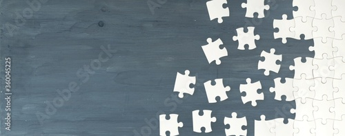 Fototapeta Classic puzzle pieces on wooden desk obraz