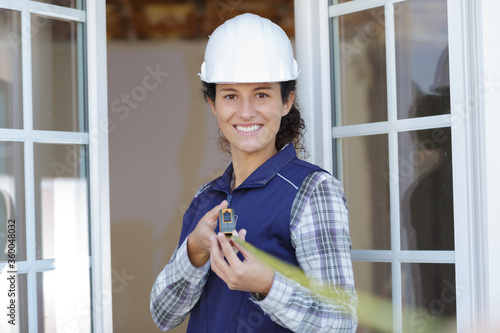 happy woman with a tape measure nce Fototapet