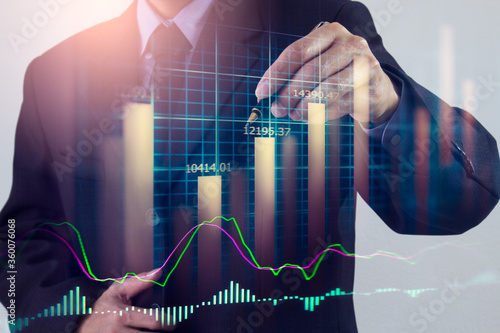 Obraz Stock market or forex trading graph and candlestick chart suitable for financial investment concept. Economy trends background for business idea and all art work design. Abstract finance background. - fototapety do salonu