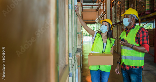 Photo factory workers work with face mask to protect coronavirus covid-19