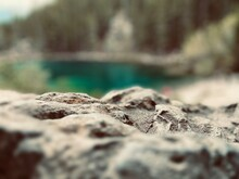 Close Up Of Rock Overlooking Pond
