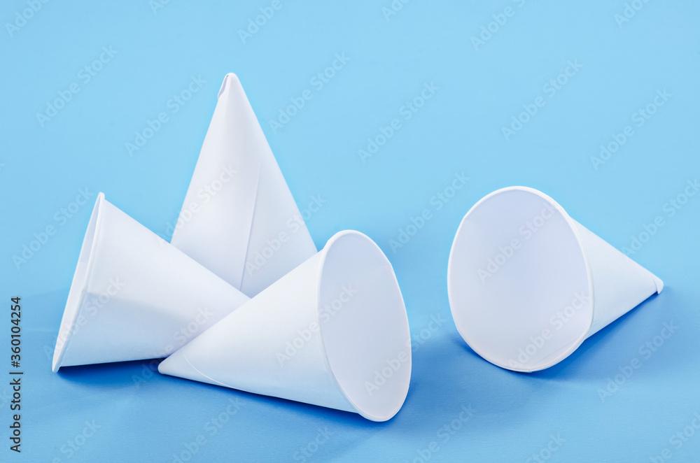 Fototapeta Disposable paper cone water cups.