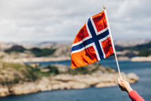 Tourist With Norwegian Flag On...