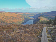 View Over The Lake From Tiny Wooden Path In National Park Wicklow Mountains In Ireland, Glendalough