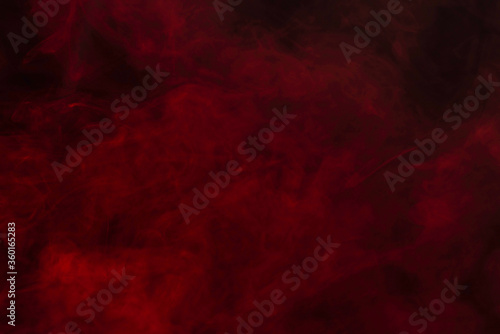 Fototapety, obrazy: Red steam on a black background.
