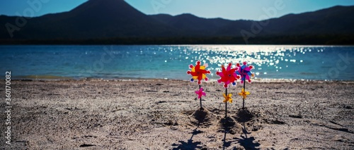 Sand beach with windmill, pinwheel toy Tapéta, Fotótapéta