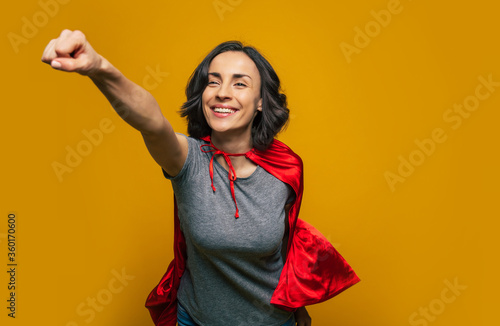I am on my way! A young, beautiful girl, pretending she is a superwoman, and flying in a classic superman pose, dressed casually, but with superman red cloak Canvas Print