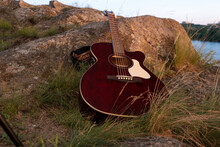 Acoustic Guitar On The Rock. G...