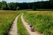 Little Boy Play On Countryside...