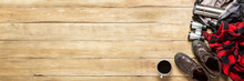 Hiking Boots, Binoculars, Shirt, Thermos, Backpack On A Wooden Background. The Concept Of Hiking, Tourism, Camp, Mountains, Forest. Banner. Flat Lay, Top View