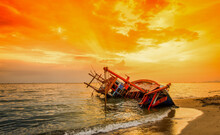 Abandoned Boat In Stormy Sea, Wooden Boat In A Stormy Sea, Boat Damaged, Boat Crash, Sunset The Beach On The Sea..