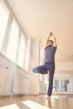 Serene Young Man Doing Yoga Ex...