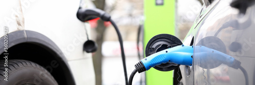 Electric cars charge batteries at the PBX closeup Fototapet
