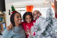 Happy Family Decorating Christ...
