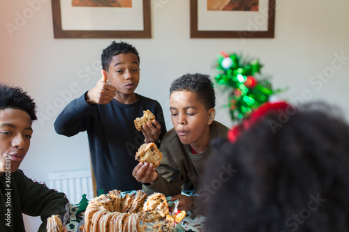 Hungry brothers eating Christmas bread
