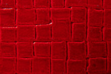 Red Lacquered Plain Leather As A Checkered Background