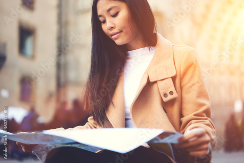 Cuadros en Lienzo Charming concentrated young hipster girl spending weekends traveling alone in ol