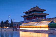 North Gate And Moat Of Forbidden City At Dusk With CITIC Tower In Background, Beijing, China