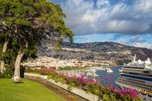 Portugal, Madeira, Funchal, Lady Sunbathing In Hotel Garden With Cruise Ship Nearby
