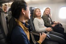 Flight Attendant Talking To Gi...