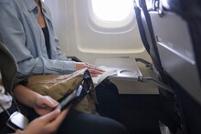 Woman Disinfecting Tray Table ...