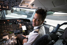 Portrait Confident Female Pilot In Airplane Cockpit