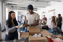 Volunteers Sorting Food Donati...